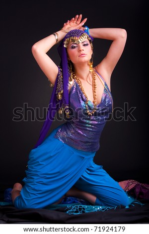 Beautiful girl in a stylized ethnic costume and shawl