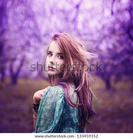 beautiful girl in a vintage style in a fabulous purple park - stock photo