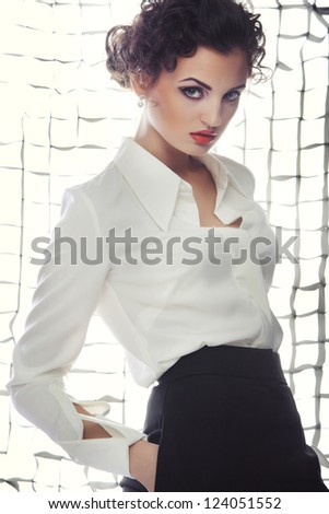 Beautiful girl in a white blouse - stock photo