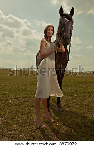 beautiful girl in a white gown with horse on nature - stock photo