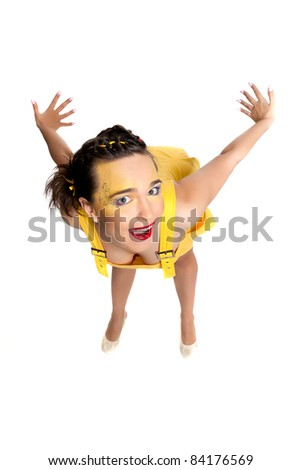 Beautiful girl in a yellow dress posing in funny poses in the studio on a white background
