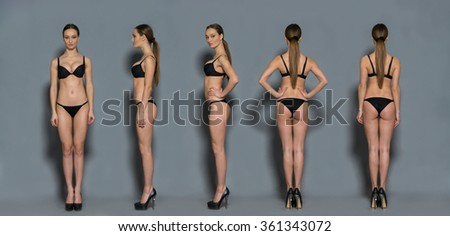 Beautiful girl in black lingerie. Front, side and rear. Isolated on gray. - stock photo