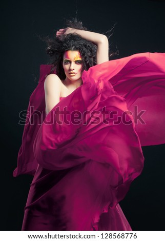 Beautiful Girl in Blowing Dress Flying - stock photo