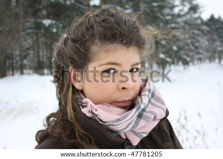 beautiful girl in cold winter near fir trees - stock photo
