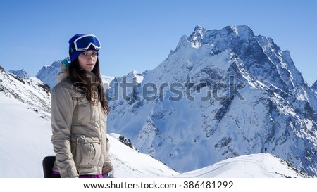 Beautiful girl in Dombai. She is a snowboarder, And it's a famous russian alps, famous russian ski resort.