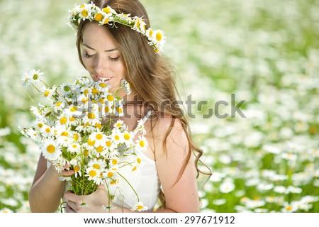 beautiful girl in dress on the daisy flowers field - stock photo