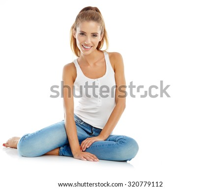 beautiful girl in fashion stylish jeans - isolated on white. Fashion model posing at studio - stock photo
