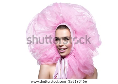 Beautiful girl in fluffy pink headwear - stock photo
