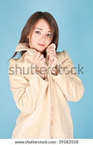 Beautiful girl in fur coat - stock photo