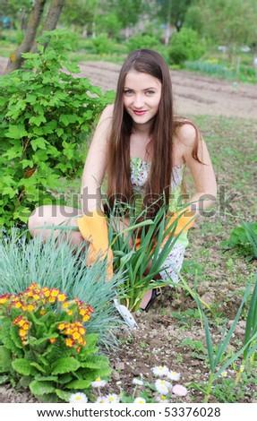 beautiful girl in garden - stock photo