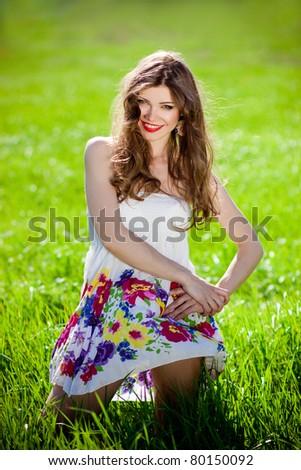 beautiful girl in grass - stock photo