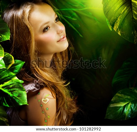 Beautiful Girl in Green Mystical Forest - stock photo