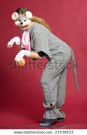 beautiful girl in grey mouse costume with orange ball over red - stock photo