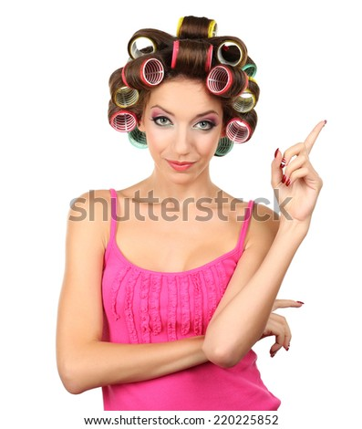 Beautiful girl in hair curlers isolated on white - stock photo