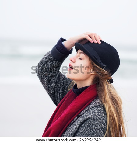 beautiful girl in hat on the beach enjoying the sunny day - stock photo