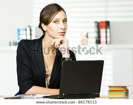 beautiful girl in office with laptop - stock photo