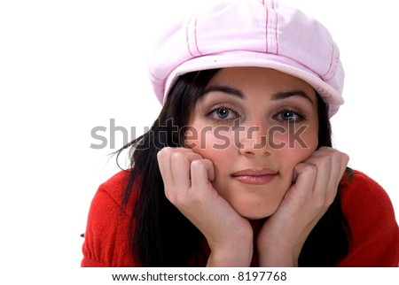 Beautiful girl in pink cap looking straight