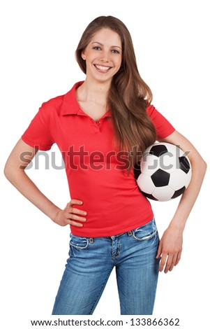 Beautiful girl in red T-shirt with a soccer ball - stock photo