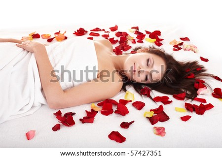 Beautiful girl in rose petal. Beauty parlour. Isolated. - stock photo