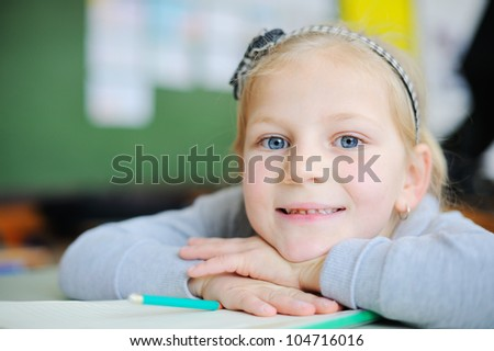 Beautiful girl in school - stock photo