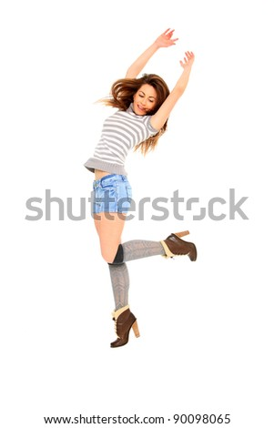 Beautiful girl in short blue jeans jumping of joy  isolated on white