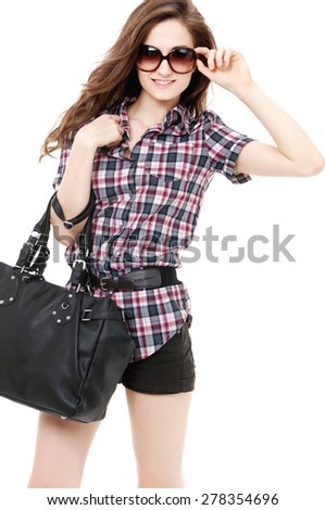 Beautiful girl in short with sunglasses and bag - stock photo