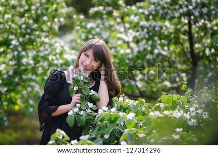 Beautiful girl in spring garden - stock photo