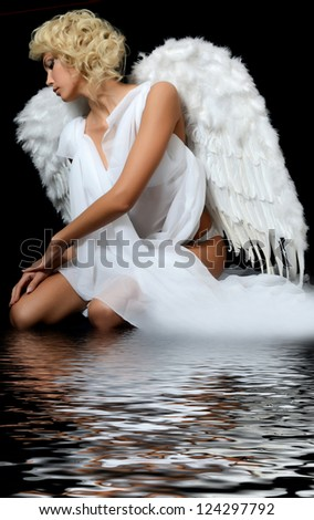 Beautiful girl in suit of white angel - stock photo