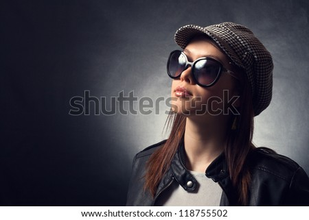 Beautiful girl in sunglasses and a cap. - stock photo