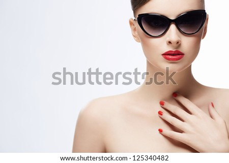 Beautiful girl in sunglasses on a white background - stock photo