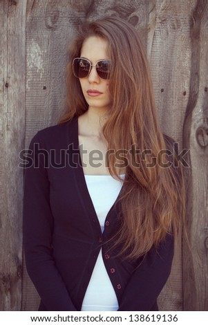 Beautiful girl in sunglasses with long hair