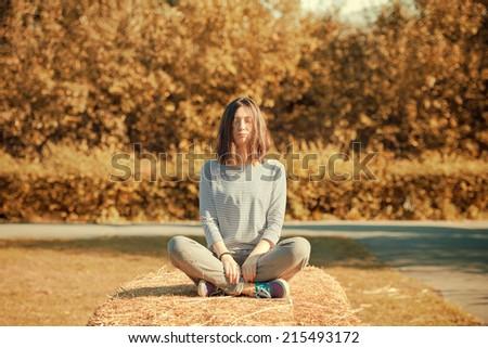 beautiful girl in the autumn park - stock photo