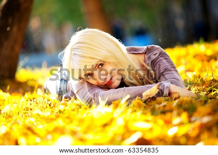 beautiful girl in the autumn park - stock photo