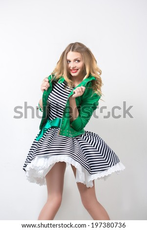 beautiful girl in the developing dress and green jacket. pin up. - stock photo