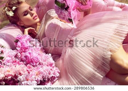 Beautiful girl in the flower garden. Princess. - stock photo