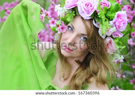 beautiful girl in the flowered garden peach