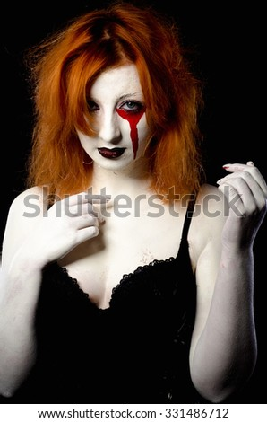 Beautiful girl in the image of halloween