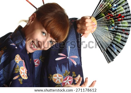beautiful girl in the Japanese national dress with a fan, vivid emotions , kimono, national traditions - stock photo