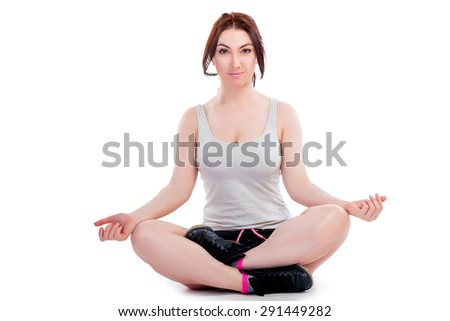 Beautiful Girl in the lotus position on a white background - stock photo