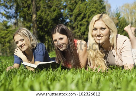 beautiful girl in the nature reading a book - stock photo