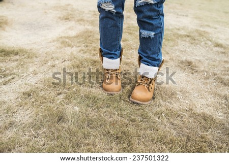 Beautiful girl in the park, close-up shoes - stock photo