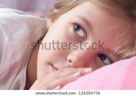 beautiful girl in the pink sheets - stock photo