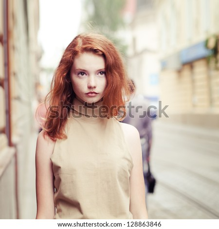 beautiful girl in the streets of the old city. vintage photo - stock photo