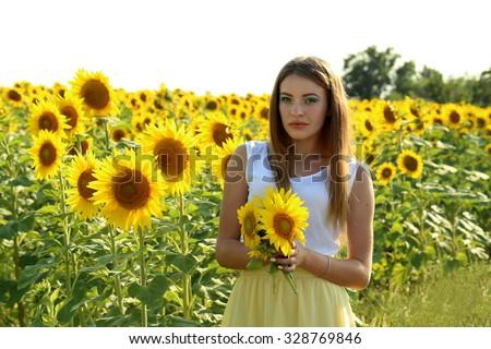 stock photo beautiful girl in the sunflowers field 328769846
