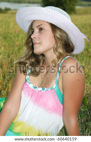 beautiful girl in the white hat in the field
