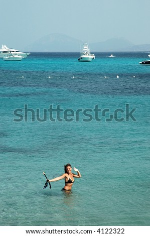 Beautiful girl in turquoise water in the Mediterranean