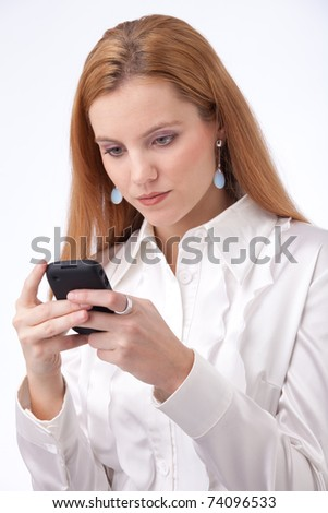 Beautiful girl in white business-shirt typing on her smartphone