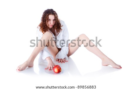 Beautiful girl in white dress with a red apple - stock photo
