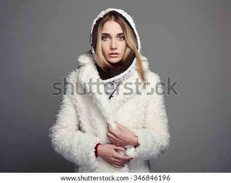 beautiful girl in white fur coat and hood. winter fashion beauty young woman  - stock photo