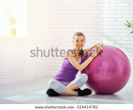 beautiful girl is engaged in sports - stock photo